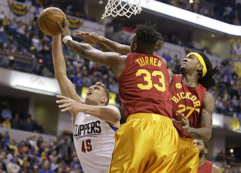 Indiana Pacers forward Myles Turner (33) and center Jordan Hill (27) block the shot of Los Angeles Clippers center Cole Aldrich (45) during the first half of an NBA basketball game in Indianapolis, Tuesday, Jan. 26, 2016. (AP Photo/Michael Conroy)