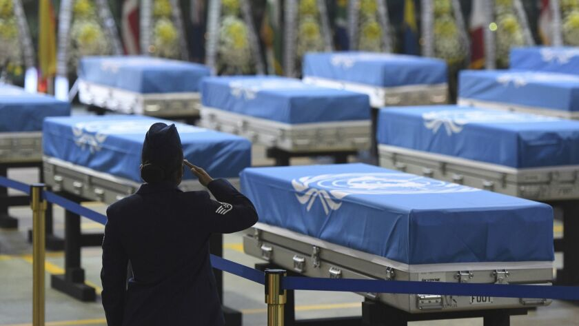 A U.S. soldier salutes during a repatriation ceremony for the remains of U.S. soldiers killed in the