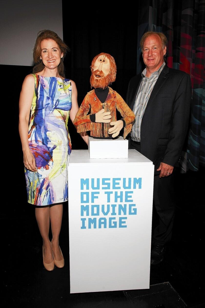 John Henson, son of Muppets creator Jim Henson, with his sister Cheryl in 2013; John Henson died Friday at 48.