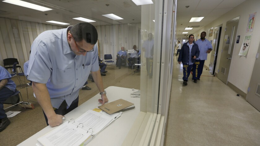 VACAVILLE, CALIFORNIA, MARCH 29, 2017: Inmate mentor Daniel Hopper prepares his notes for the Offend