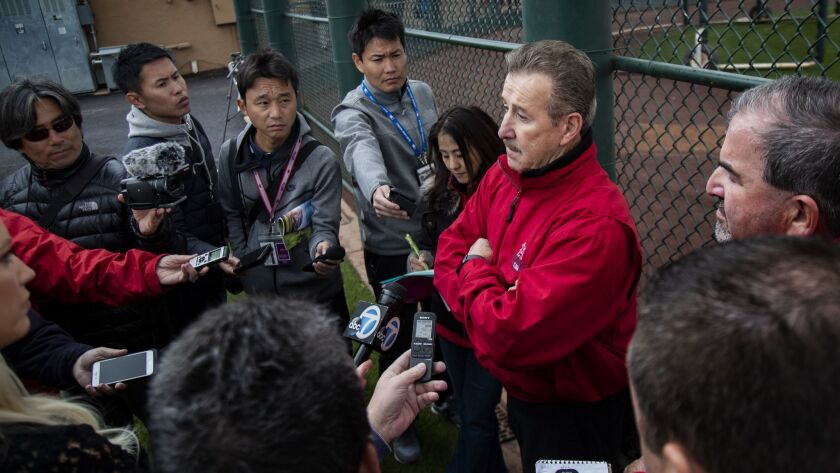 TEMPE, AZ - FEBRUARY 18, 2019: Angels owner Arte Moreno talks with reporters during spring training