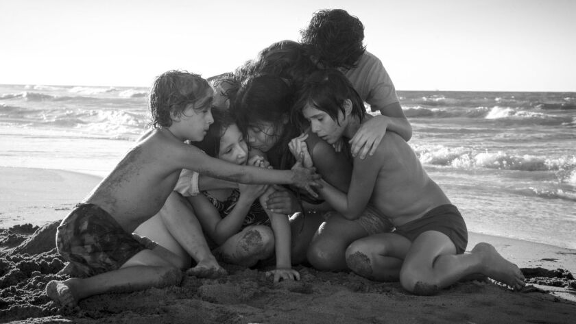 "This image released by Netflix shows Yalitza Aparicio, center, in a scene from the film ""Roma,"" by f"