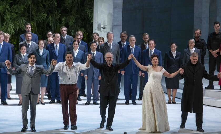 """Valery Gergiev, center, accepts the bravos at curtain call for """"Simon Boccanegra"""" at the Salzburg Festival."""