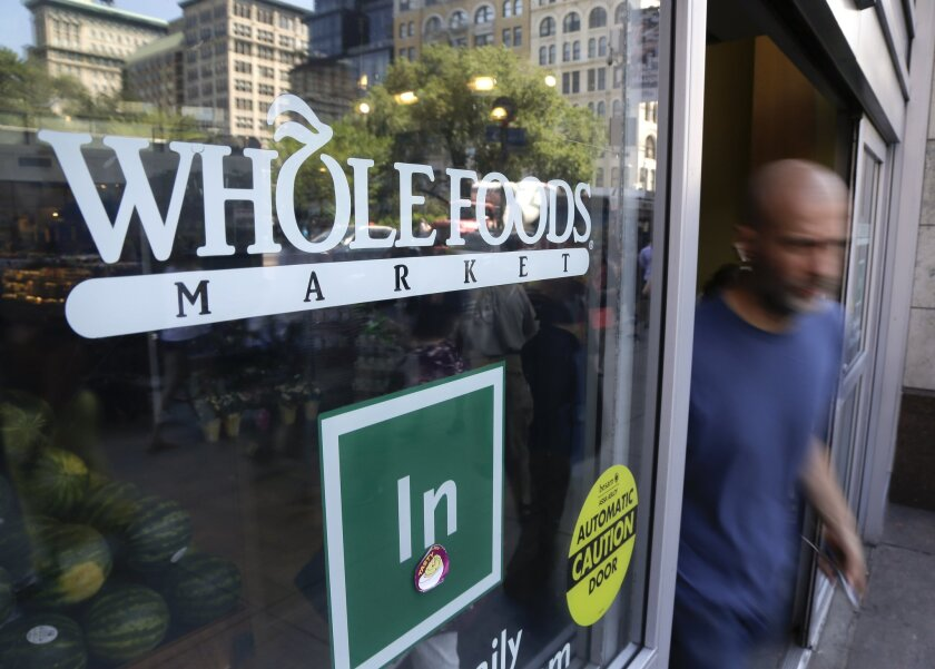 A shopper leaves the Whole Foods Market store in New York's Union Square on June 24.