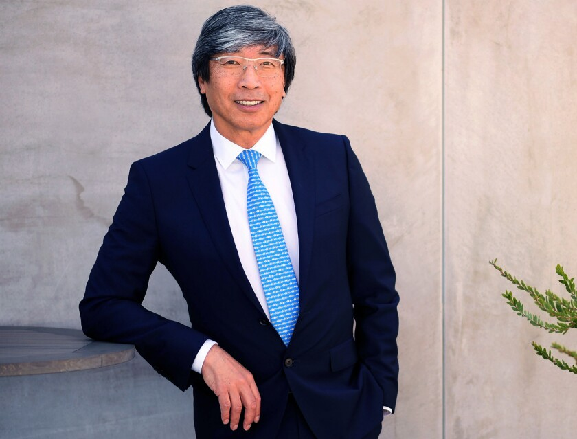 Patrick Soon-Shiong posing for a photo at his office.