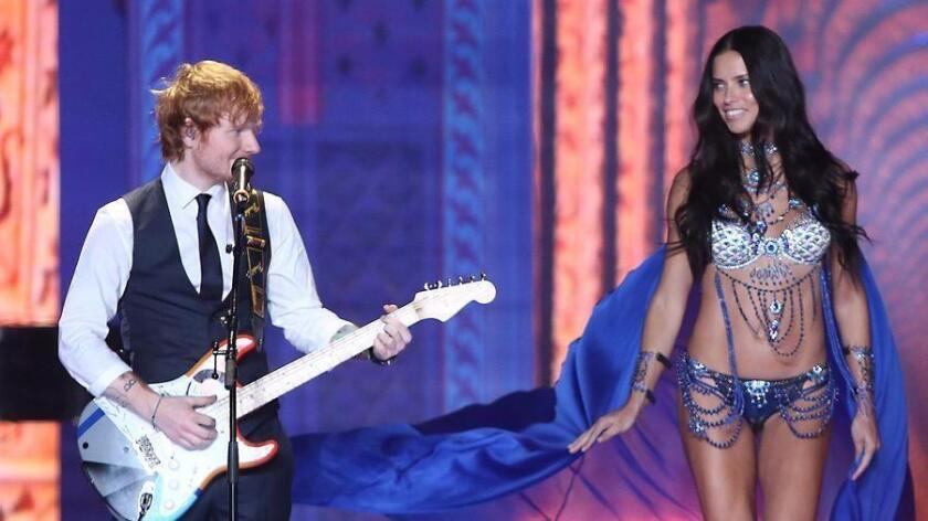 Ed Sheeran performs alongside model Adriana Lima at the Victoria's Secret fashion show in London. (Joel Ryan/Invision/AP)
