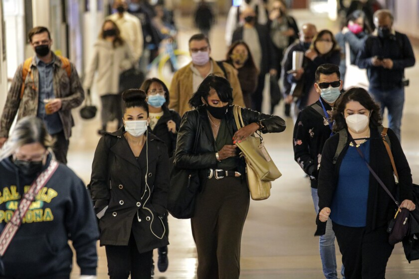 Commuters wear face masks at Union Station in Los Angeles.