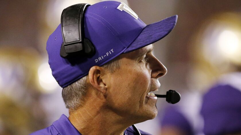 Washington head coach Chris Petersen looks on in the second half during an NCAA college football gam