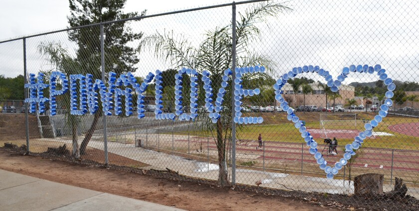 Student-decorated fence outside of Poway High School.