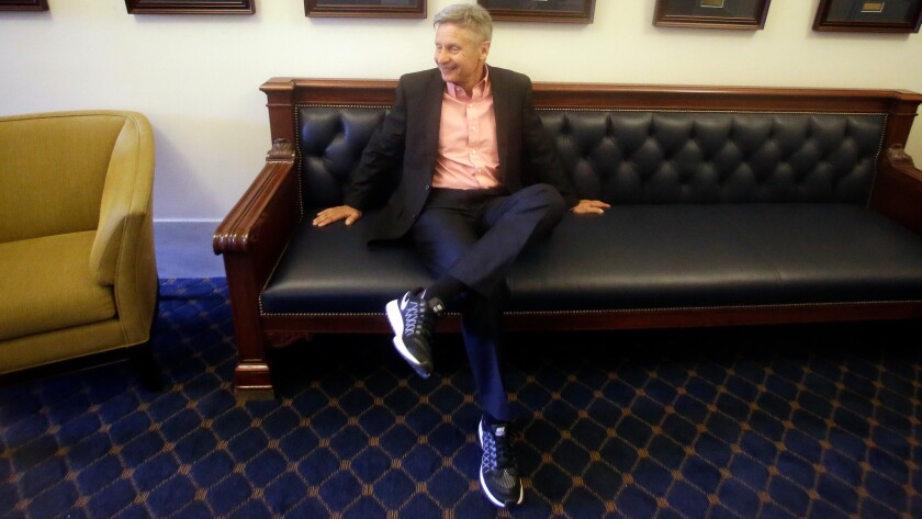 Former New Mexico Gov. Gary Johnson waits to speak with legislators at the Utah State Capitol in Salt Lake City on May 18.