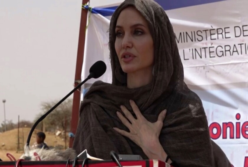 In this image taken from video, Special Envoy to the United Nations High Commissioner for Refugees Angelie Jolie speaks at the Malian refugee camp in Goudebo, Burkina Faso, Sunday June 20, 2021, to mark World Refugee day on Sunday. Hollywood actress Angelina Jolie has visited war-weakened Burkina Faso to show solidarity with people who continue to welcome the displaced, despite grappling with their own insecurity, and said the world isn't doing enough to help. (AP Photo)