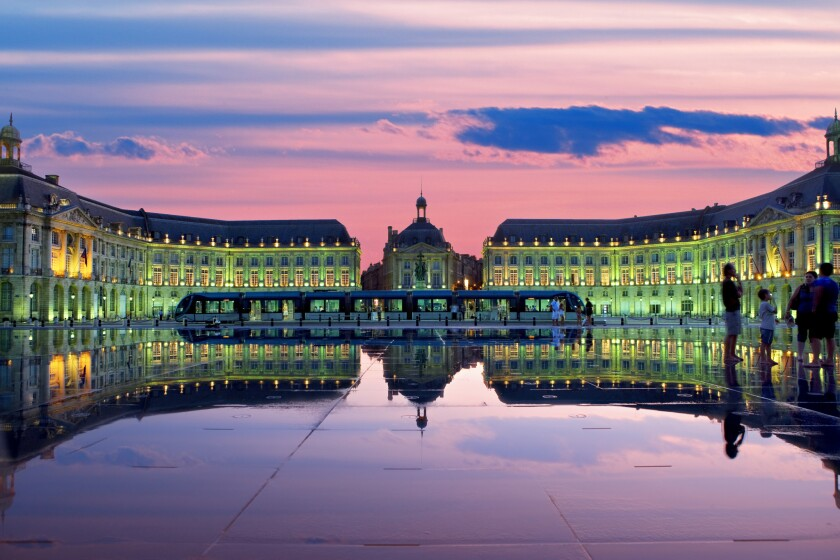 Ornamental water feature in Bordeaux at dusk.