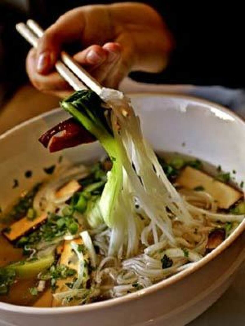 Pho Chay, tofu, and straw mushrooms, onions, bok-choy, bean sprouts, basil and noodles served in a vegetable broth.