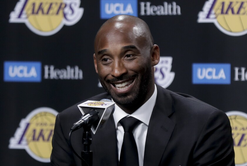FILE - In this Dc. 18, 2017, file photo, former Los Angeles Laker Kobe Bryant talks during a news conference in Los Angeles. Kobe Bryant was a major proponent of women's basketball, and his posthumous induction into the Basketball Hall of Fame this weekend will be alongside three legends of the women's game in Kim Mulkey, Tamika Catchings and Barbara Stevens. (AP Photo/Chris Carlson, File)