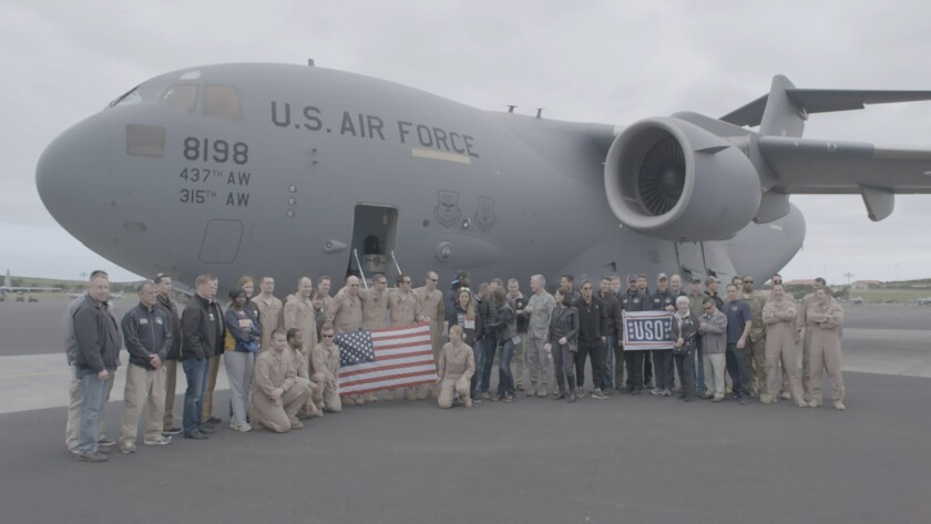 """A USO troupe and their military road crew and transport, as seen in the documentary """"USO: For the Troops."""""""