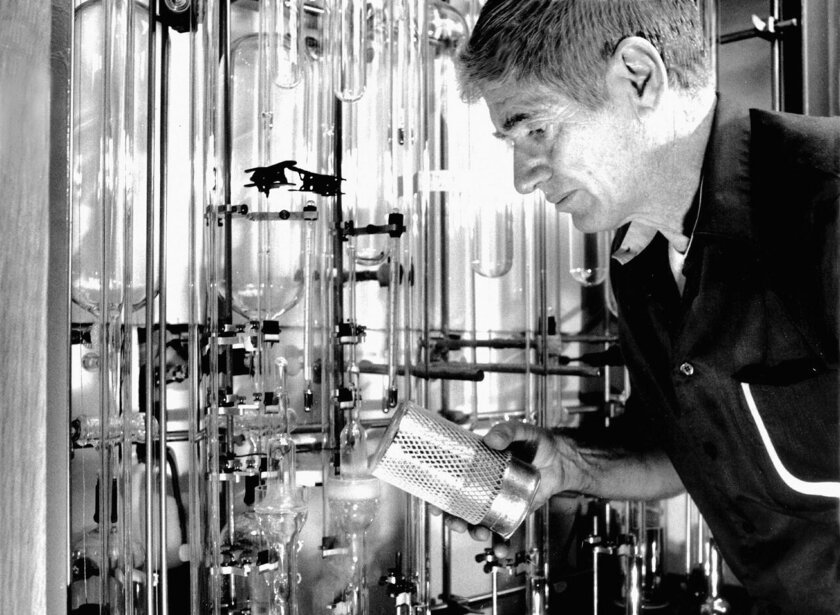 This photo provided by Scripps Institution of Oceanography, UC San Diego, taken Oct. 19, 1988, shows Charles David Keeling working with the Scripps manometer, which is used to measure amounts of CO2 by freezing it out of air.  He's pouring liquid nitrogen which chills the glass chamber to do the CO