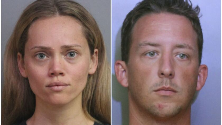 Booking photos provided by the Polk County Sheriff's Office show Courtney Irby, left, and her husband Joseph Irby.