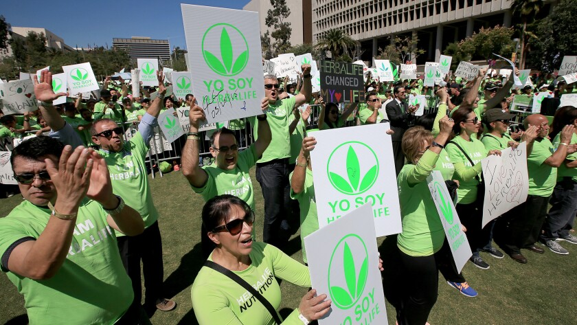But where are the distributors' mansions? Herbalife got some of the faithful to turn out for a pro-company demonstration in downtown Los Angeles last year.