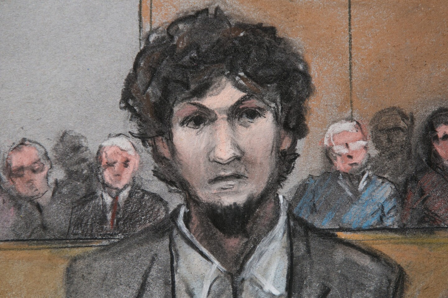 A somber-looking Dzokhar Tsarnaev stood with his hands folded, his head slightly bowed, as he learned his fate May 15, 2015.