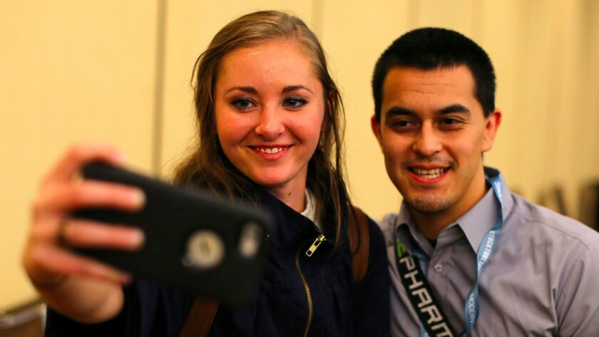 Millennial stock blogger and trader Rachel Fox, 20, is asked to take a picture with a fan after speaking to a group of investors, tech nerds and stock traders at StockTwits annual Stocktoberfest in