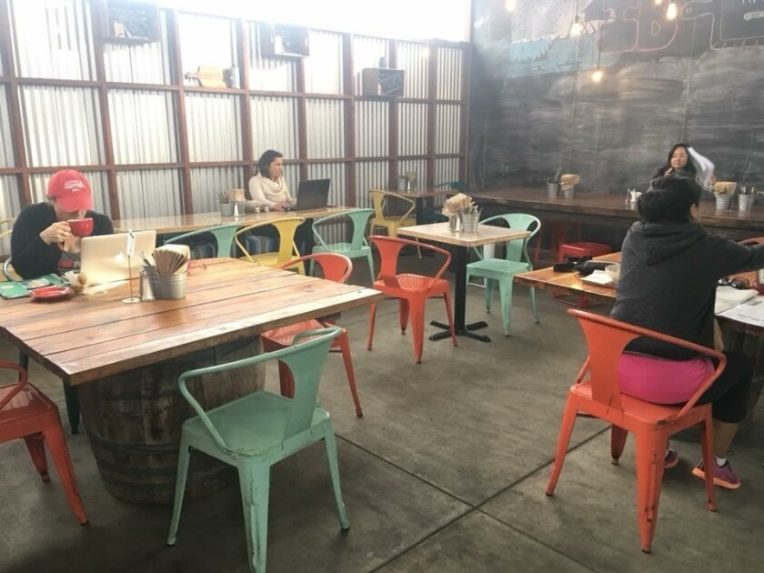 Red House Kitchen dons colorful chairs, wooden tables and reusable tableware for guests to use.