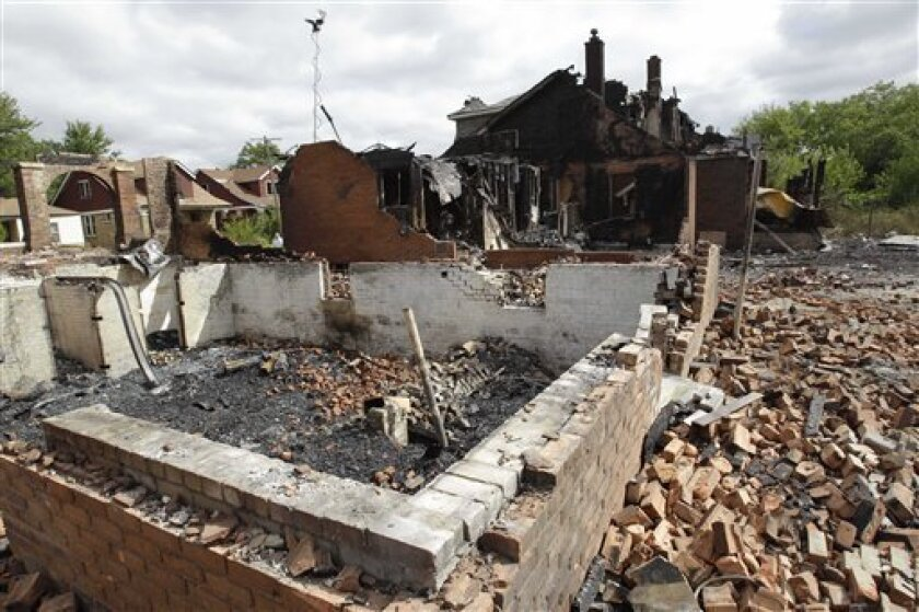 Foundations to several homes on Detroit's east side are seen Wednesday, Sept. 8, 2010. Wind-whipped flames swept through at least three Detroit neighborhoods, destroying dozens of homes, including many that were vacant, officials said. (AP Photo/Carlos Osorio)