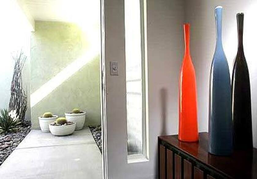 The tall, brightly colored bottles in Brad Cook's Palm Springs home create a midcentury Modern mood as soon as you step through the door.