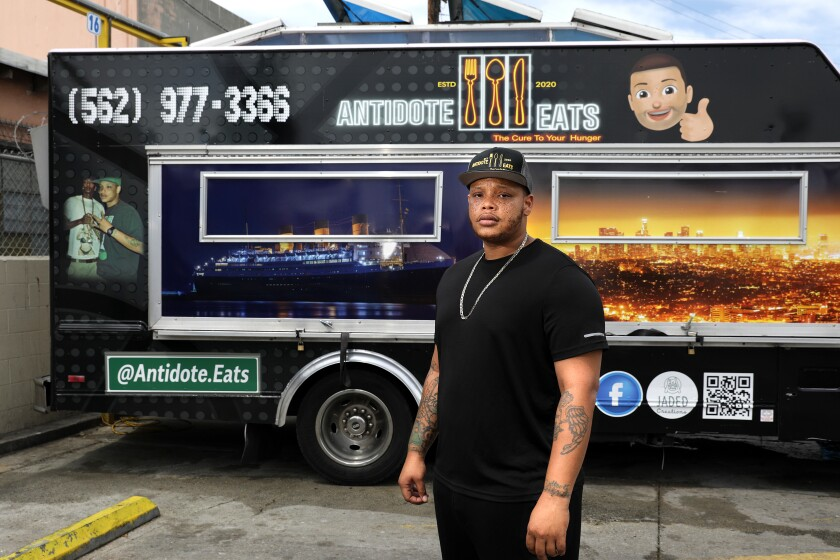Anthony Suggs stands in front of his food truck, Antidote Eats.