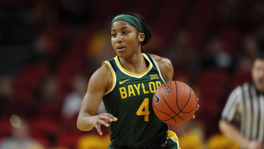 Baylor guard Te'a Cooper drives upcourt in an NCAA college basketball game against Iowa State.