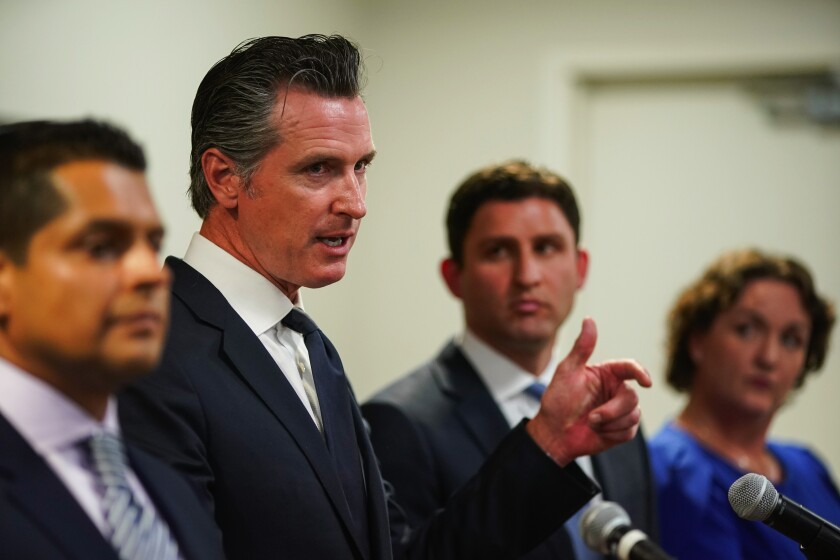 GOV. GAVIN NEWSOM on Wednesday in Los Angeles with Assemblymen Miguel Santiago, left, and Jesse Gabriel, and Rep. Katie Porter.