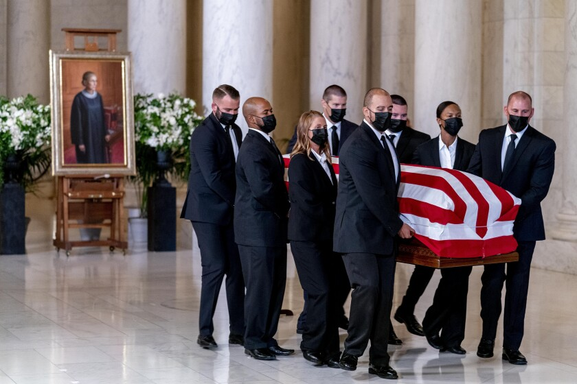 The flag-draped casket of Justice Ruth Bader Ginsburg arrives at the Supreme Court in Washington on Wednesday.