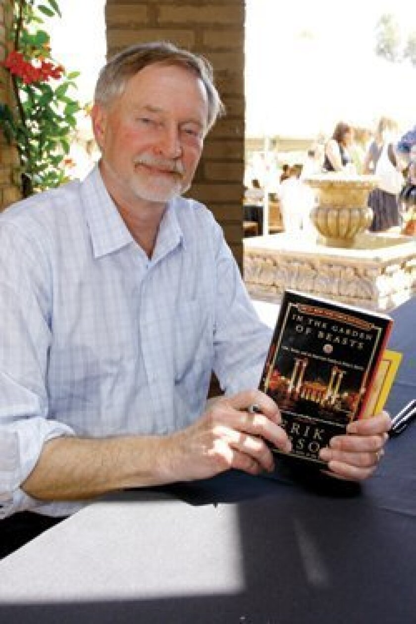 "Author Erik Larson with his book ""In the Garden of Beasts."""