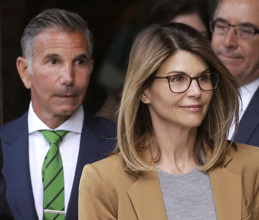 Lori Loughlin, front, and husband Mossimo Giannulli, left, leave court.