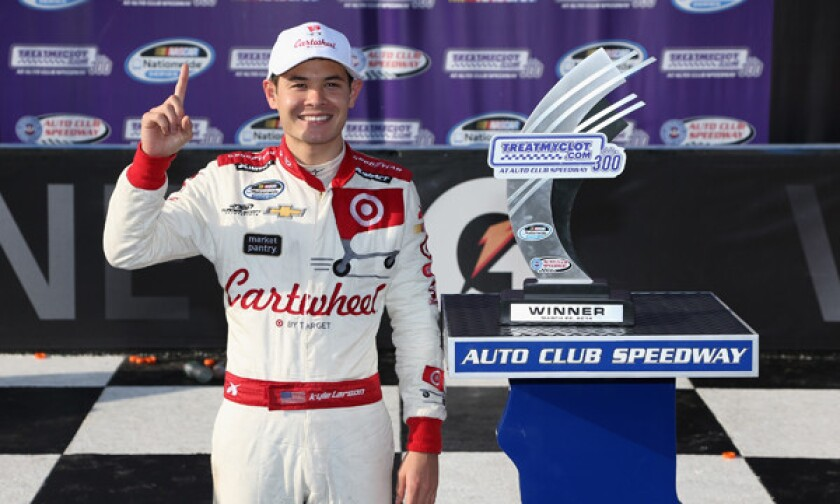 Kyle Larson celebrates after winning Saturday's NASCAR Nationwide Series race at Auto Club Speedway in Fontana.