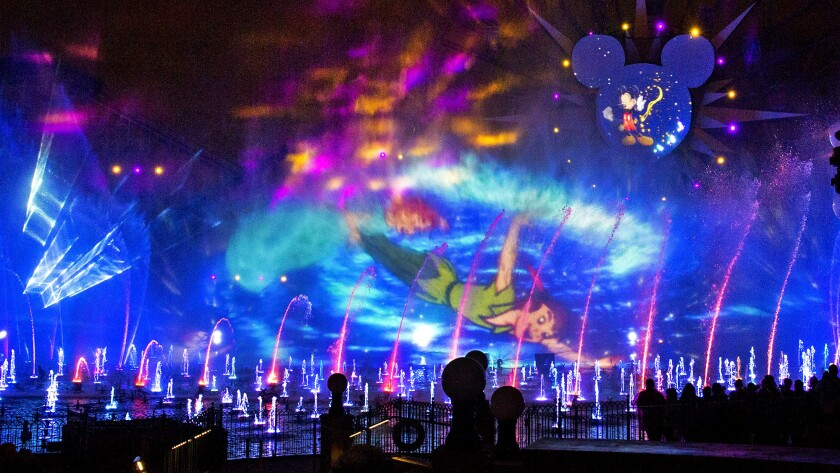 """A three-dimensional projection of Peter Pan flying through a mist during the launch of Disney California Adventure Park's """"World of Color"""" for the park's 60th anniversary celebration Wednesday, May 20, 2015. The event is a preview of the Disneyland Resort Diamond Celebration, a special event celebrating the 60th anniversary of Walt Disney's original theme park in Southern California."""