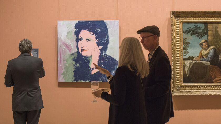 """Andy Warhol's portrat of Ileana Sonnabend hangs in a gallery at the Timken Museum in Balboa Park. The new exhibit """"Metonymies: A Dialogue of Twentieth-Century Works from the Sonnabend Collection"""" runs through April 28."""
