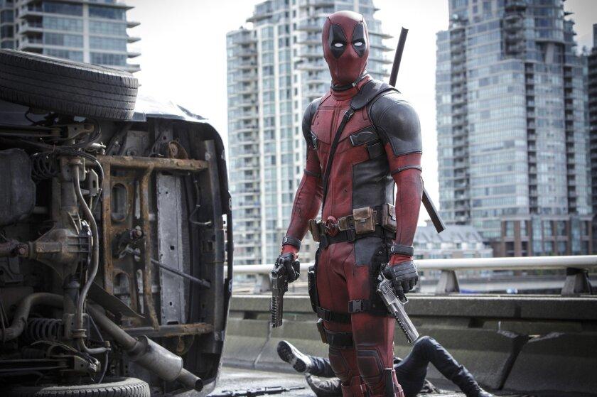 "This image released by Twentieth Century Fox shows Ryan Reyonlds in a scene from ""Deadpool."" (Joe Lederer/Twentieth Century Fox Film Corp. via AP)"