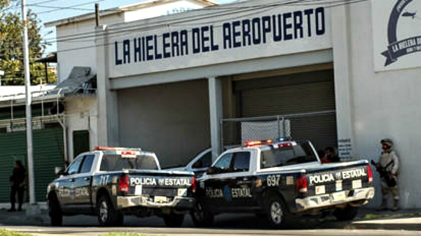 Vehicles from Baja California's state police stationed Thursday outside an ice-making business southwest of Tijuana's airport that hid the opening to a clandestine drug tunnel.
