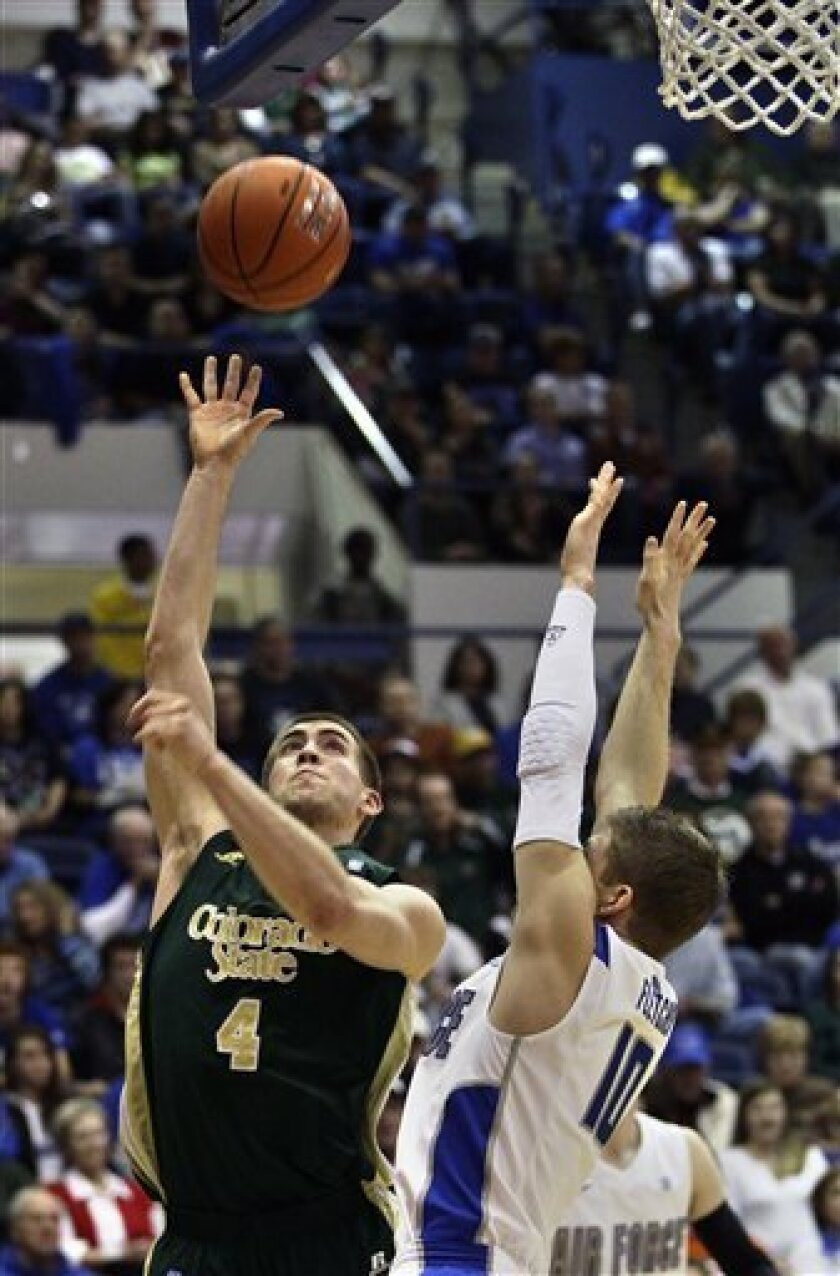 Colorado State's Pierce Hornung , left, shoots as Air Force's Todd Fletcher, right, goes up for a block during the first half of an NCAA college basketball game in Air Force Academy, Colo., Saturday Feb. 16, 2013. Colorado State won 89-86. (AP Photo/Brennan Linsley)