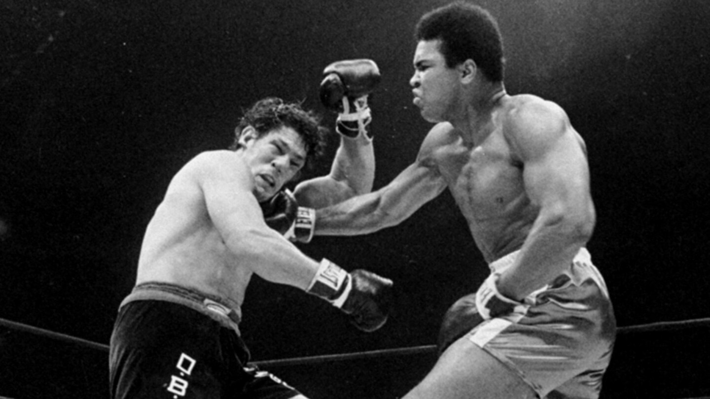 Muhammad Ali, right, punches Oscar Bonavena during the third round of their heavyweight title fight on Dec. 7, 1970, at Madison Square Garden in New York. Ali won by technical knockout in the 15th round.
