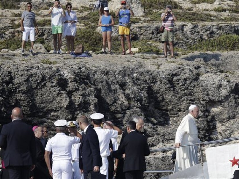 Pope Francis, right, boards an Italian Coast Guard boat upon his arrival at the island of Lampedusa, southern Italy, Monday, July 8, 2013. Pope Francis heads Monday to the Sicilian island of Lampedusa for his first pastoral visit outside Rome, going to the farthest reaches of Italy to pray with mig