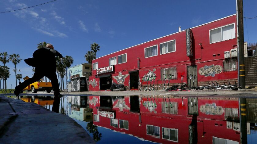 Water pools at the intersection of Horizon Avenue and Speedway in Venice Beach after a brief rainstorm on Mar. 20.