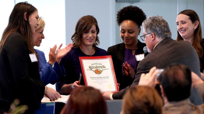 City of Glendale Principal Economic Development Officer Jennifer Hiramoto, center, accepted a certif
