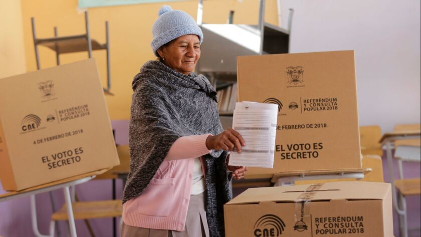 A woman casts her vote during a constitutional referendum called by President Lenin Moreno in Quito,