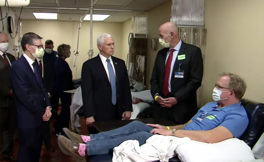 Vice President Pence meets with staff and a patient at the Mayo Clinic. You might notice he's the only one not wearing a mask.