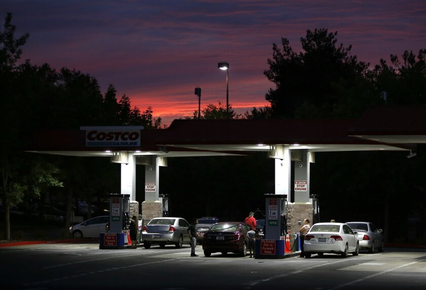 In this Wednesday, Sept. 30, 2015, photo, motorists get gas at a Costco station in Sacramento, Calif. Fuel experts, economists and consumer advocates are expected to appear at a hearing of the Petroleum Market Advisory Committee, Monday, Feb. 8, 2016, to discuss why California gas prices are consis