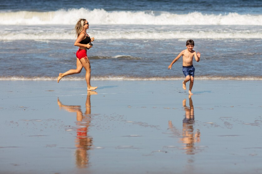 Los Angeles County beaches reopened on Wednesday, but only for those who keep moving.