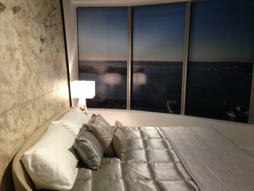 The model at the Pacific Gate sales office shows how residents might overlook the city from their bedroom.