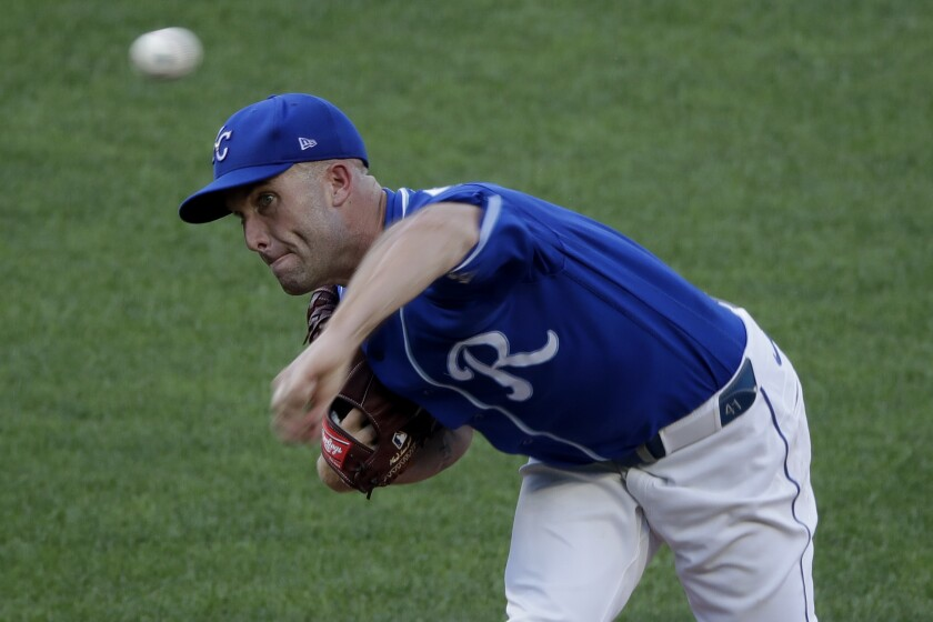 Kansas City Royals pitcher Danny Duffy throws during an intrasquad baseball game at Kauffman Stadium on Wednesday, July 8, 2020, in Kansas City, Mo. (AP Photo/Charlie Riedel)