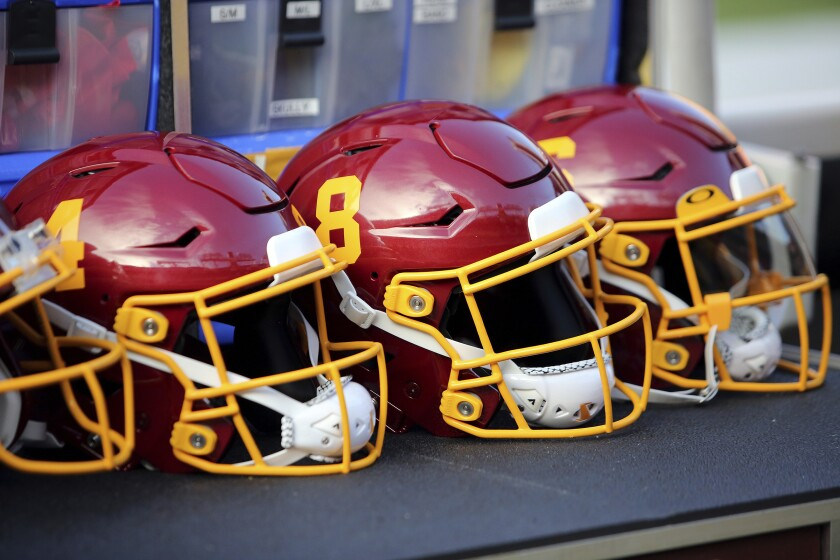 FILE - Washington Football Team helmets are shown before an NFL preseason football game against the Cincinnati Bengals in Landover, Md., in this Friday, Aug. 20, 2021, file photo. The NFL Players Association says it has sent a formal request to the league for information about Washington's practice facility being searched last week by federal authorities. (AP Photo/Daniel Kucin Jr., File)